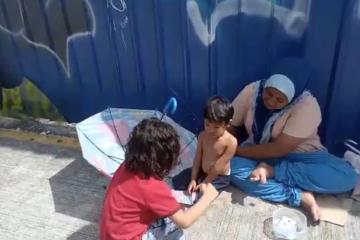 Boy Gives His Own Shoes To A Barefooted Homeless Youngster