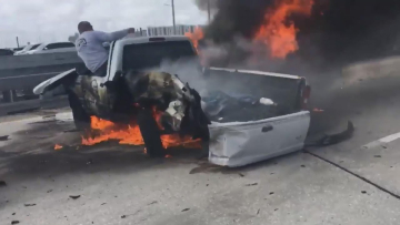 2 Heroes Rescue Driver Trapped Inside Burning Truck