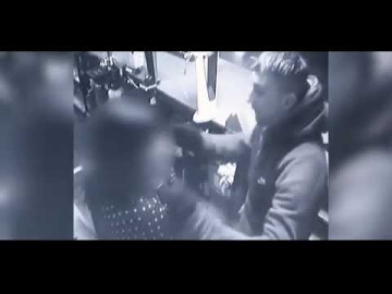Masked robber is recognised by victim held at gunpoint and hugs her