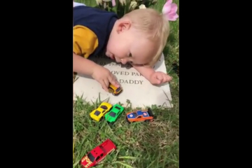 Heartbreaking moment toddler sings goodbye to his dad's headstone